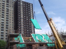 Glasgow House roof panel craned into position