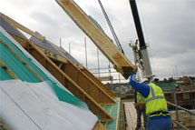 crane moving roof panel into place